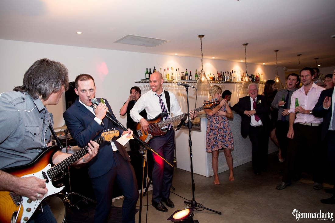 The groom sings with the band at his wedding reception - Biota Dining Wedding