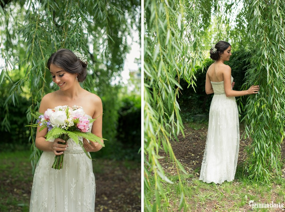 A bride posing with her bouquet beneath a tree - Backyard Wedding