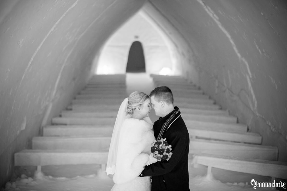 Black and white version of bride and groom exchanging an eskimo kiss in an ice chapel with noone around. This was from the top of the aisle - Gemma Clarke Photography Highlights for 2013
