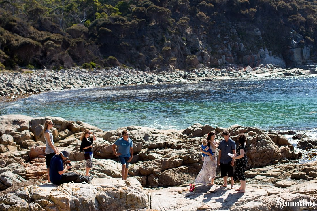 A relaxed, intimate wedding ceremony by the water at Bluestone Bay in Tasmania