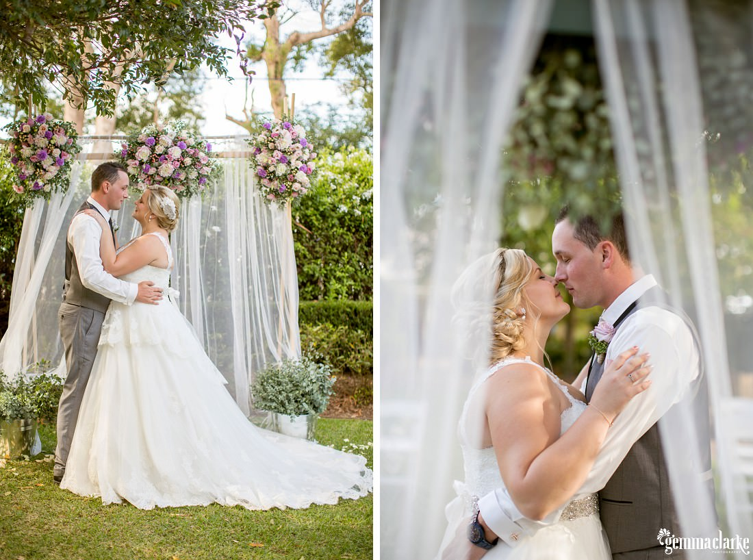 Bride and Groom almost kissing in front of their floral sheer curtain wedding arch that was used for the garden ceremony at this Merribee Wedding