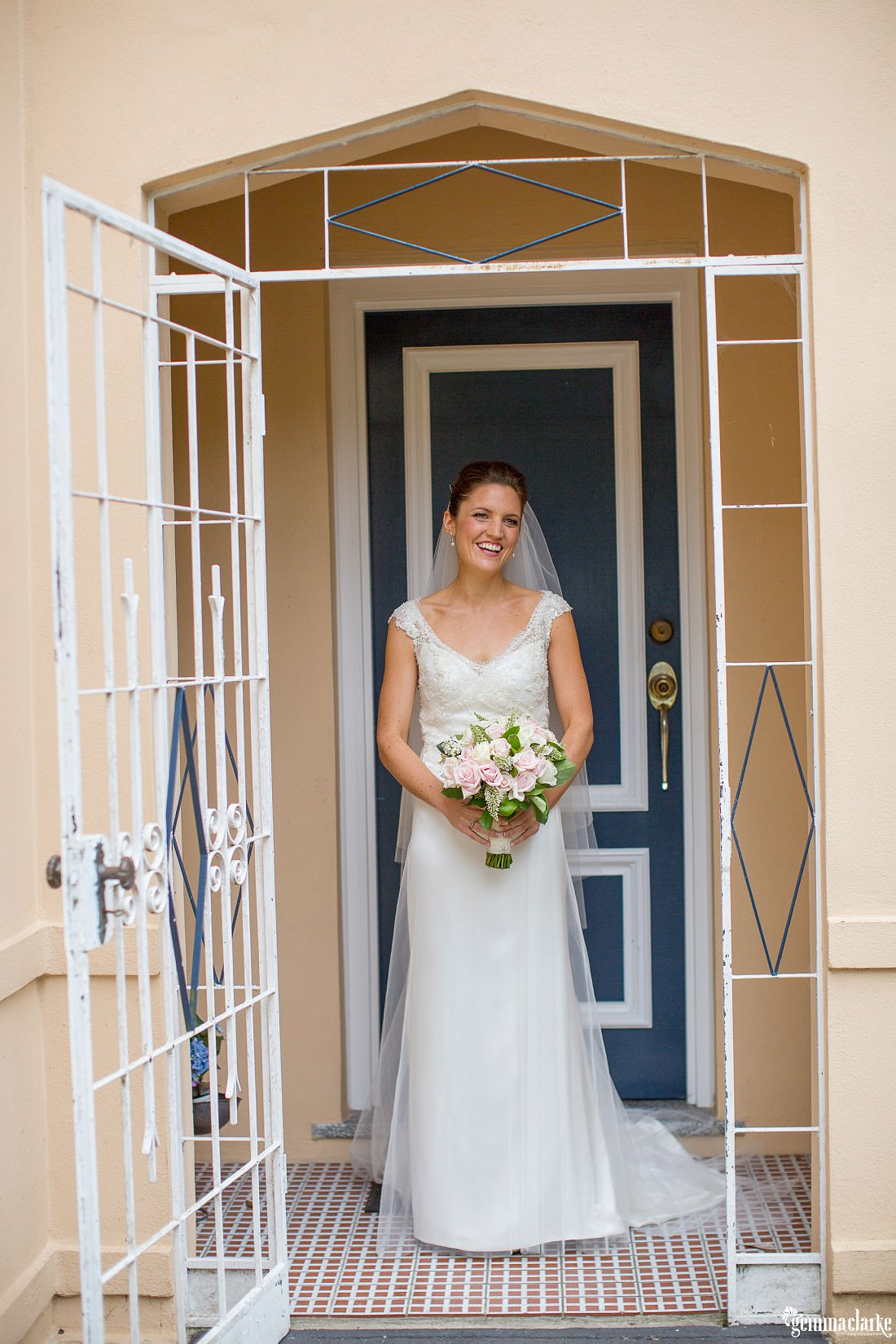 A bride posing on the front doorstep - Hunter's Hill Wedding
