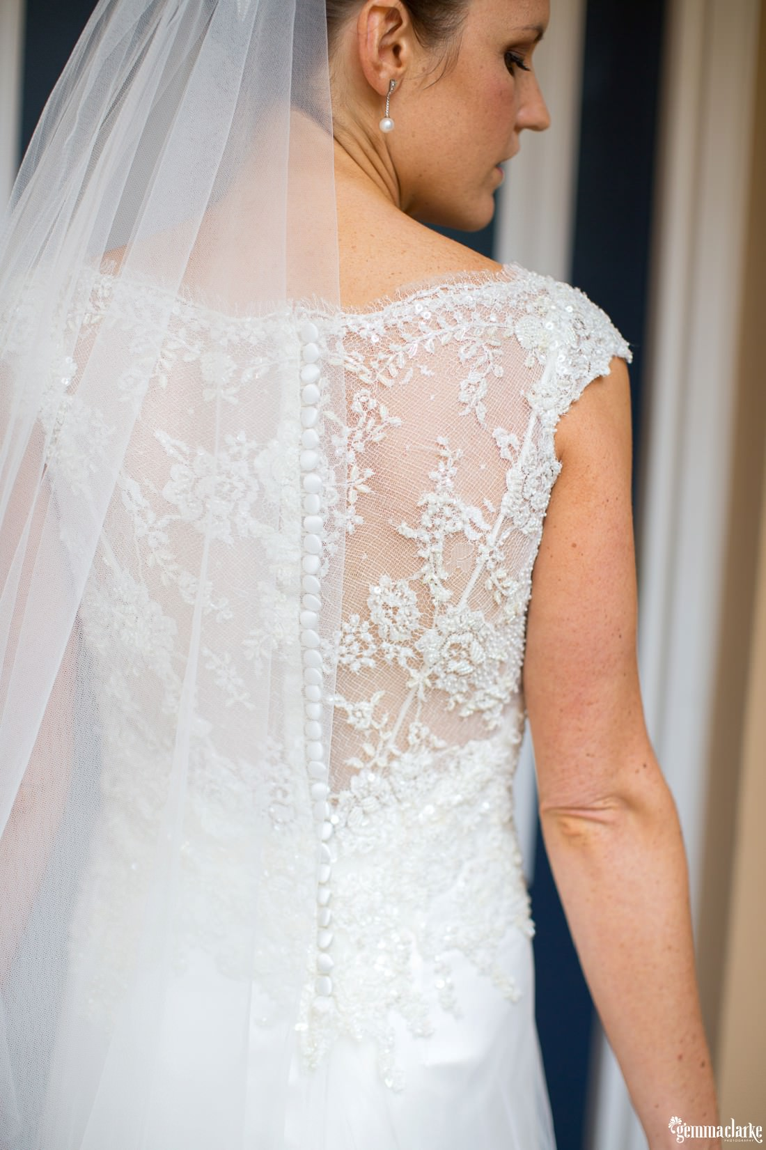 The lacy back of a bride's wedding gown - Hunter's Hill Wedding