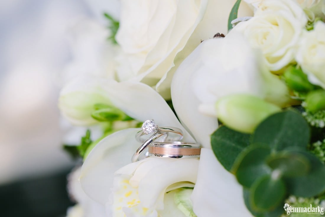 Engagement and wedding rings among white flowers - Bowral Winter Wedding