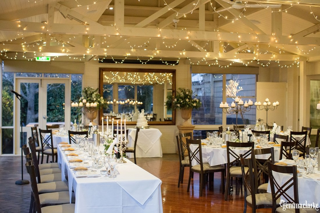 White reception setup under fairly lights - Bowral Winter Wedding