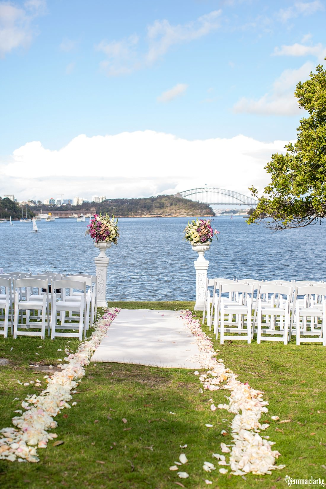 Outdoor wedding ceremony setup by the water with the Sydney Harbour Bridge in the background - Woolwich Wedding