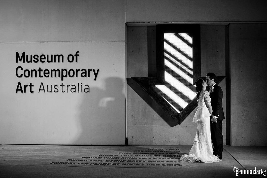 A bride and groom kiss outside the Museum of Contemporary Art - Vaucluse House Wedding