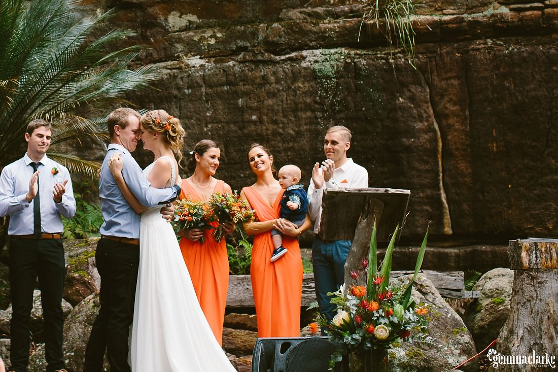 A bride and groom about to kiss during their wedding ceremony – Kangaroo Valley Bush Retreat