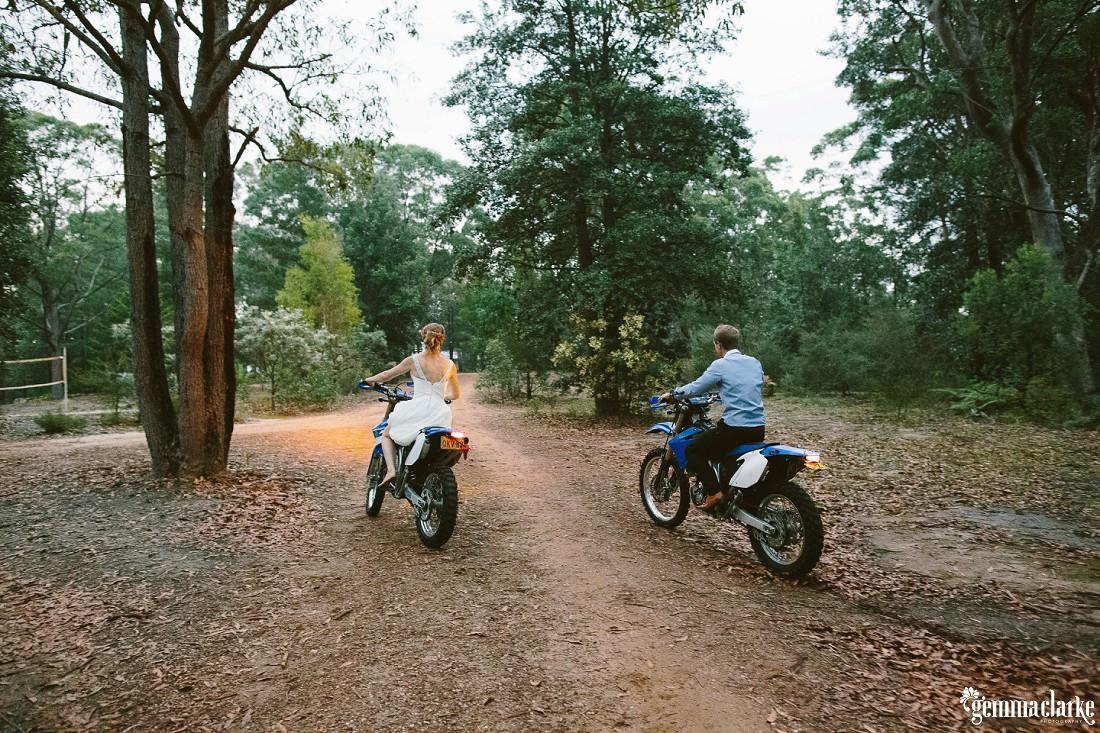 A bride and groom riding dirty bikes – Kangaroo Valley Bush Retreat