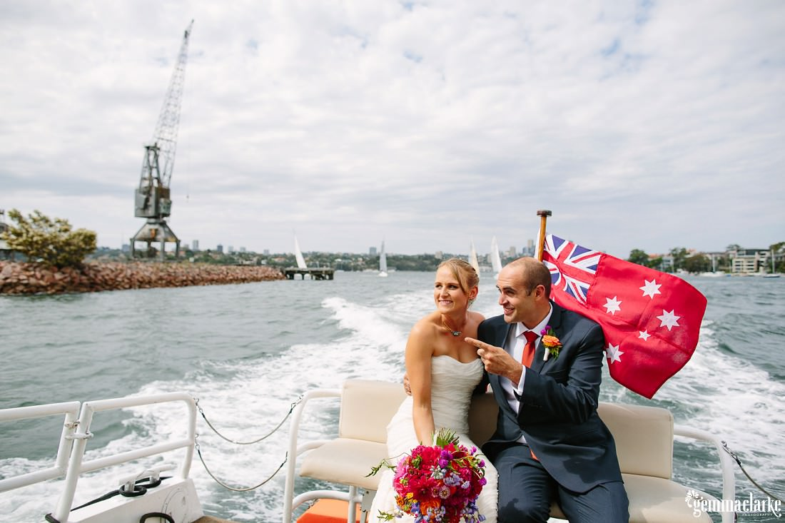 A bride and groom at the back of a boat on Sydney Harbour - The Theatre Bar at the End of the Wharf Wedding