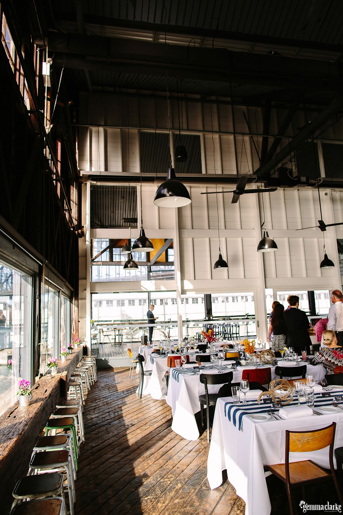 A wedding reception setup at a The Theatre Bar at the End of the Wharf Wedding