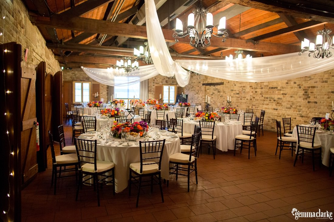 Italian Village Reception Room with brightly coloured floral styling - Wedding in the Rocks