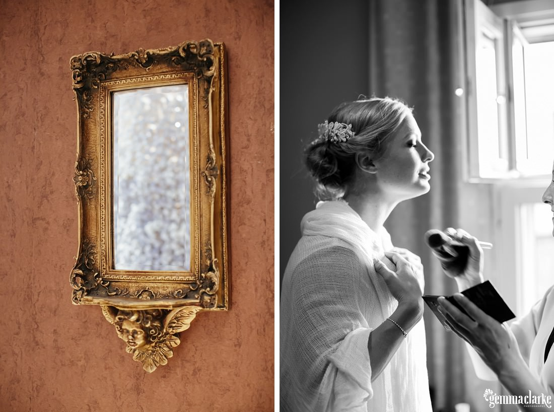 A gold framed mirror and a bride having make up applied