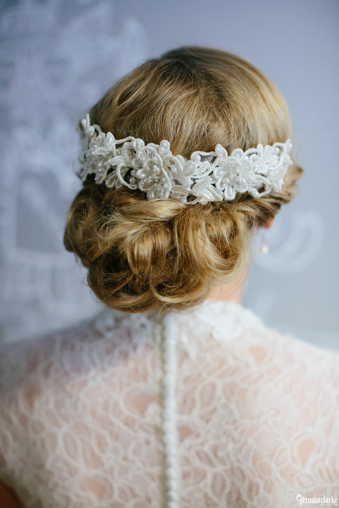 A close up of a bride's hair and hairpiece