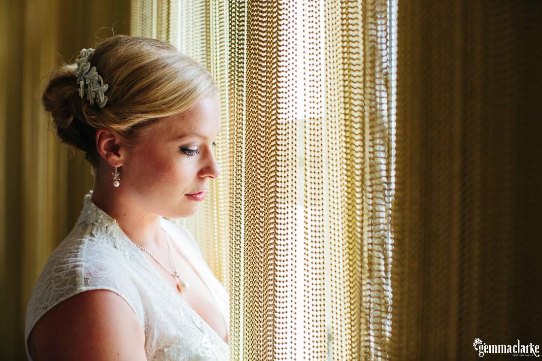A bride near a beaded curtain