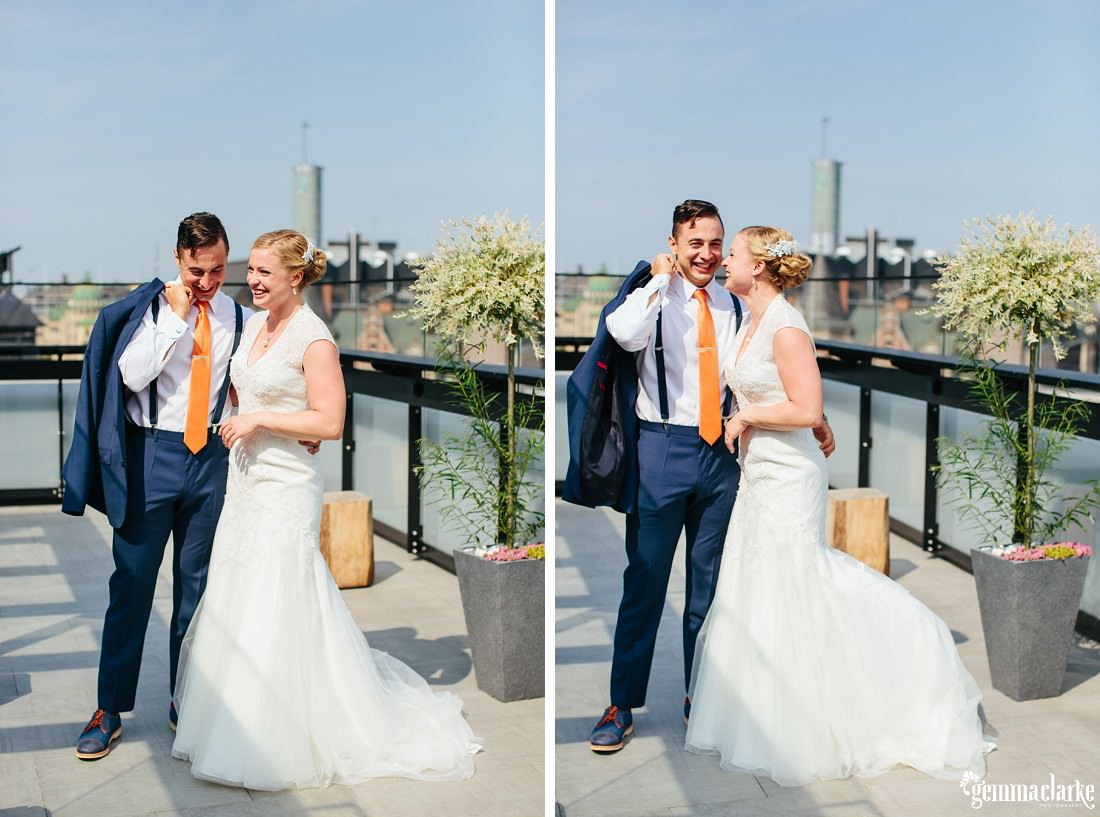A bride and groom smiling together on a rooftop terrace