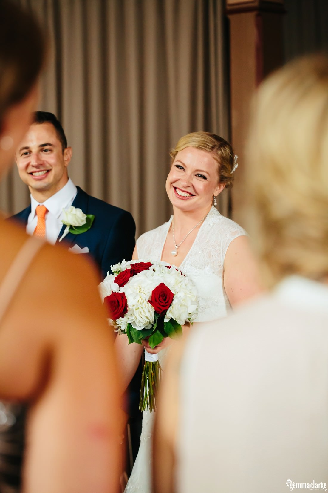 A smiling bride and groom at their wedding ceremony
