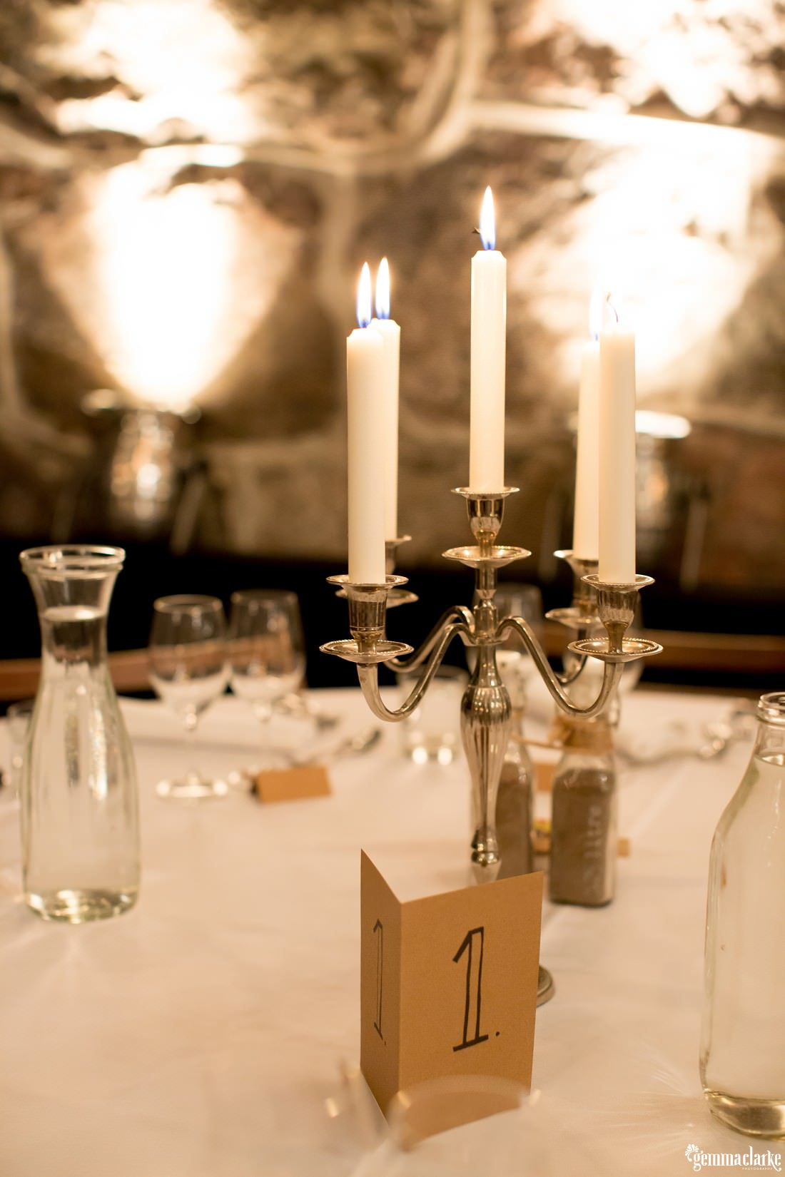A close up of a candelabra on a table at a wedding reception