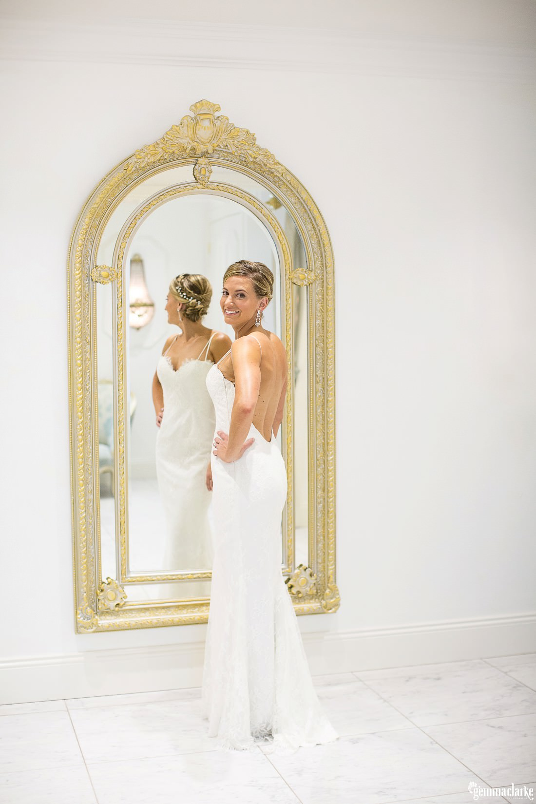Bride posing in front of a gold framed mirror - Jaspers Wedding