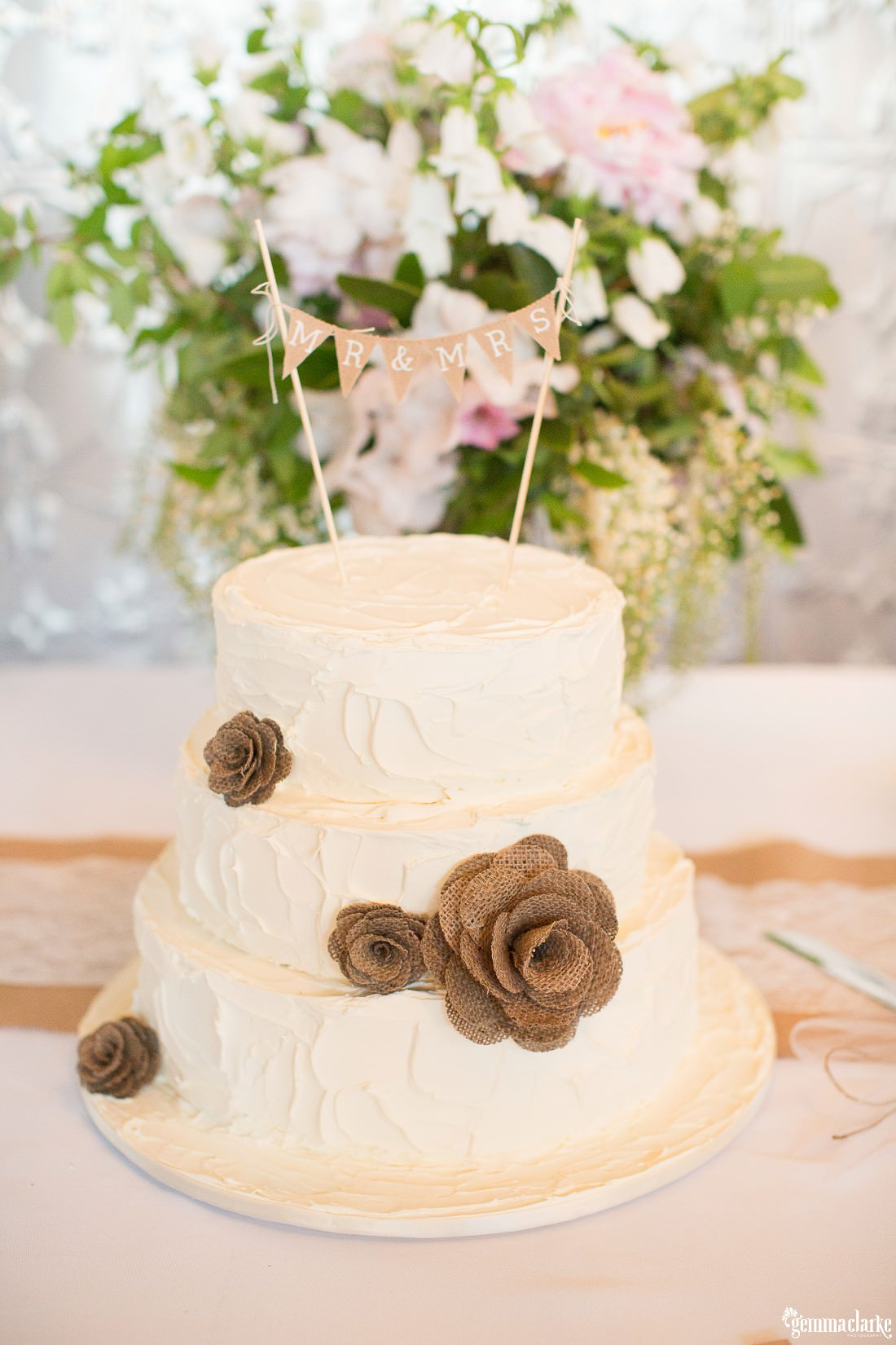 Three tiered wedding cake with hessian flowers - Mali Brae Farm Wedding