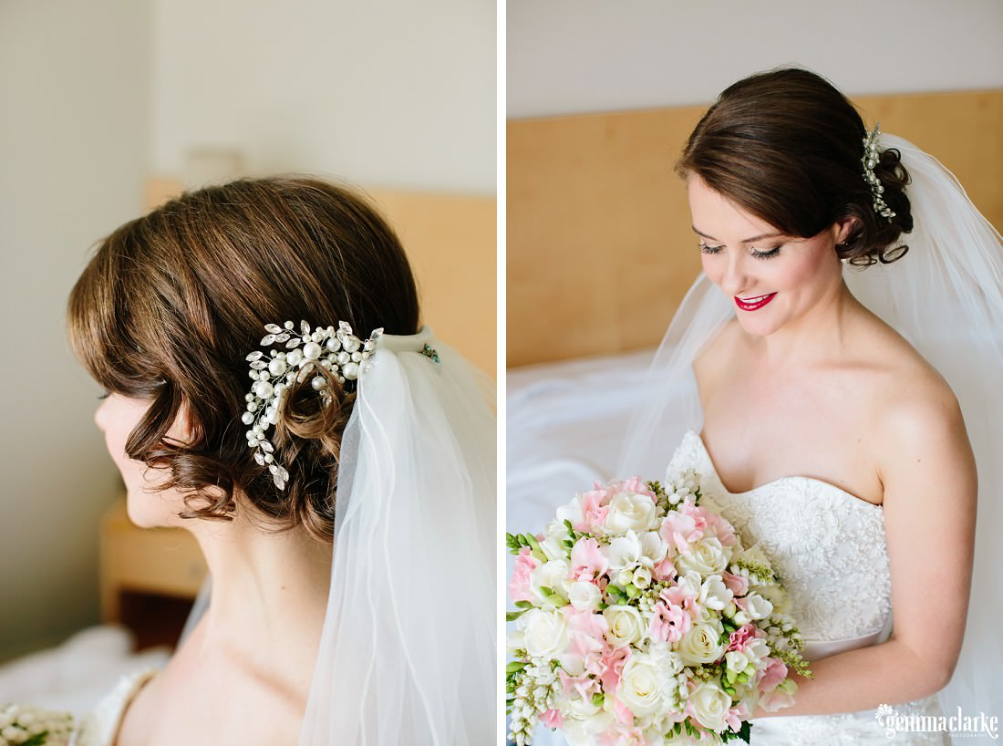 A smiling bride sitting on a bed and looking down at her bouquet, and a close up of her hair, hairpiece and veil