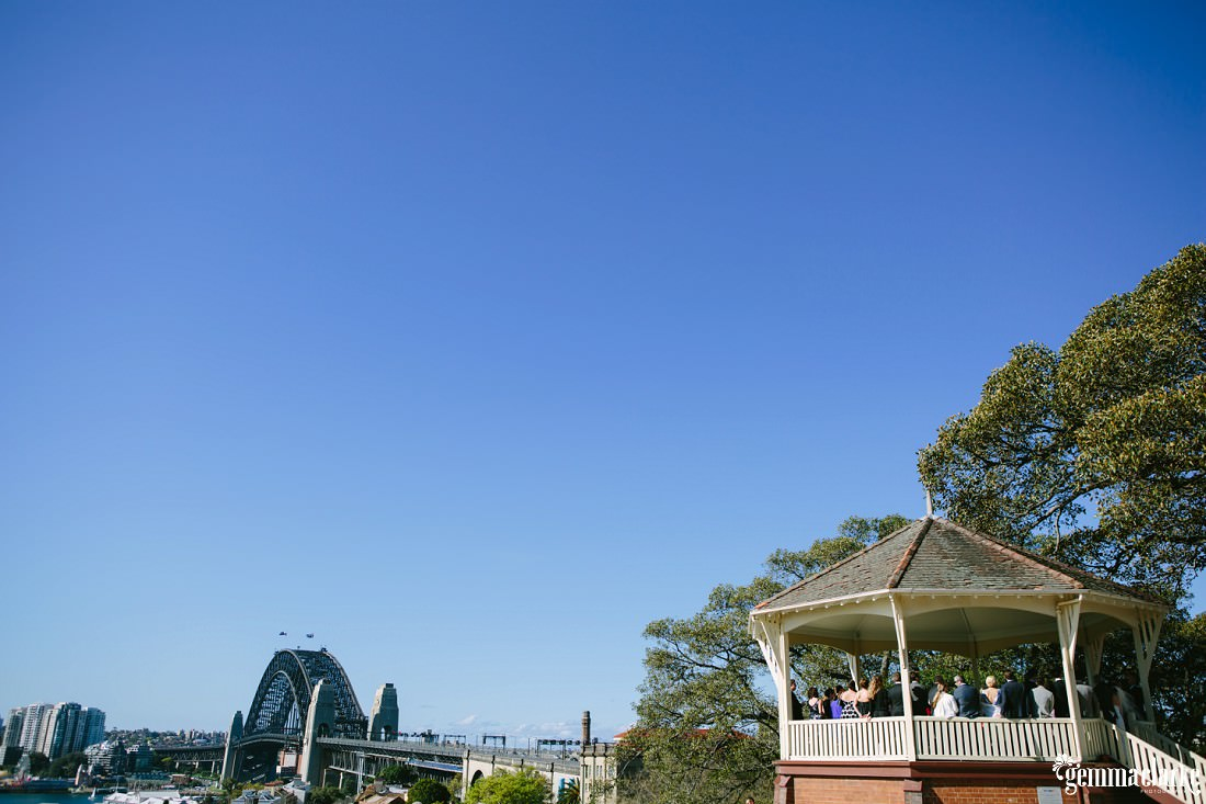 Observatory Hill and the Sydney Harbour Bridge under a blue sky