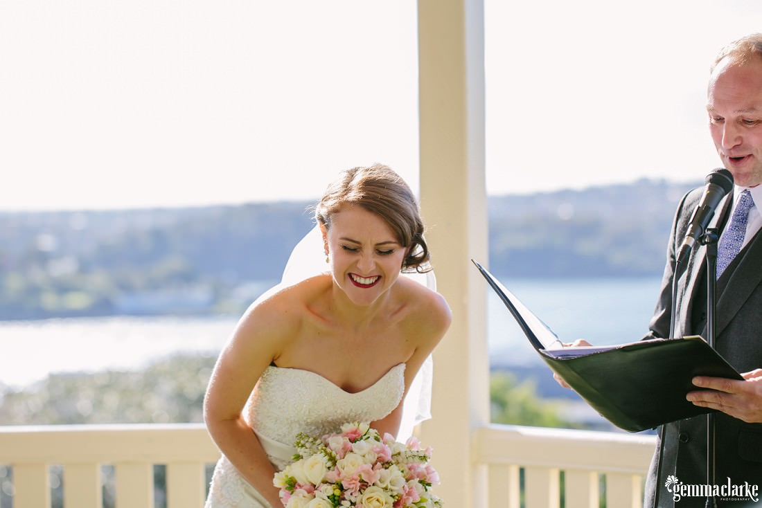 A bride laughing during her ceremony