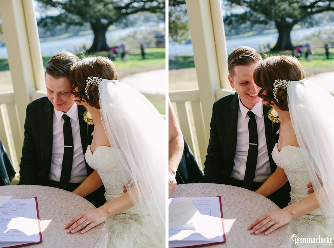 A bride and groom sharing a moment at their signing table