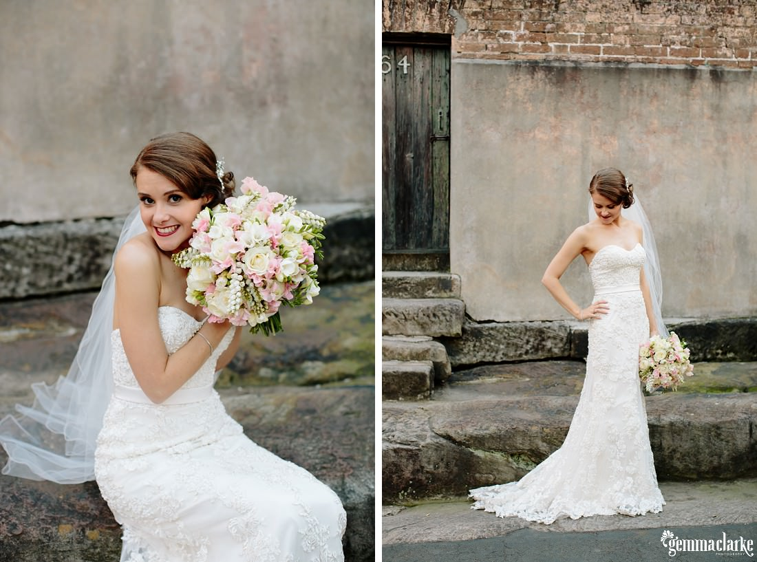 A bride posing and showing off her dress and bouquet