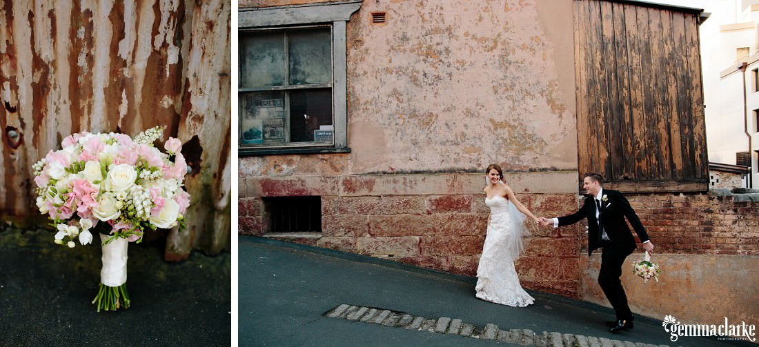 A close up of a bouquet, and a bride leading her groom up an hill in front of an old building