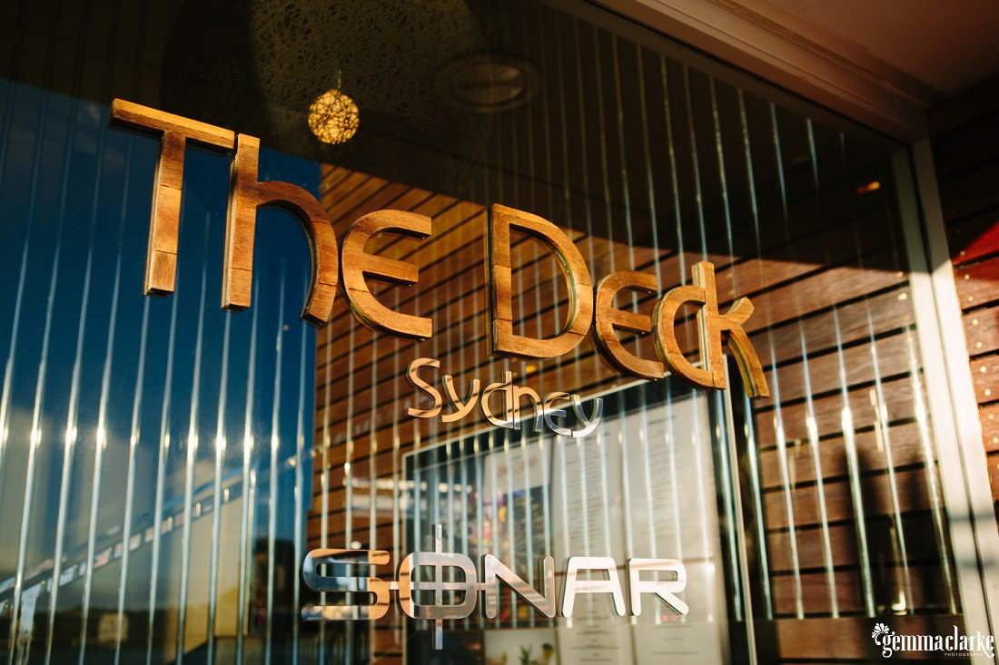 "A window with a sign saying ""The Deck, Sydney"""
