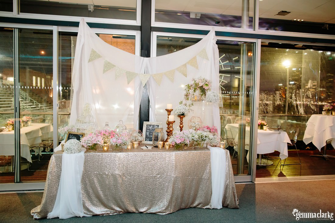 Decorative styling table with flowers, bunting and large candlesticks