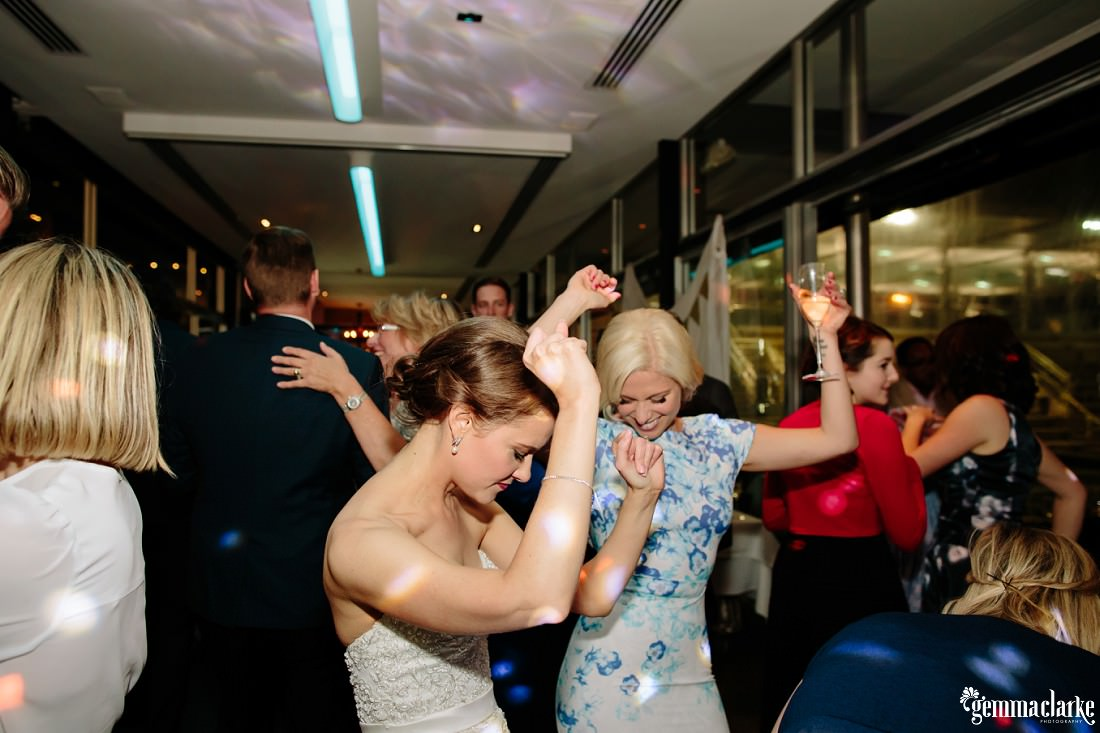 A bride dancing with guests