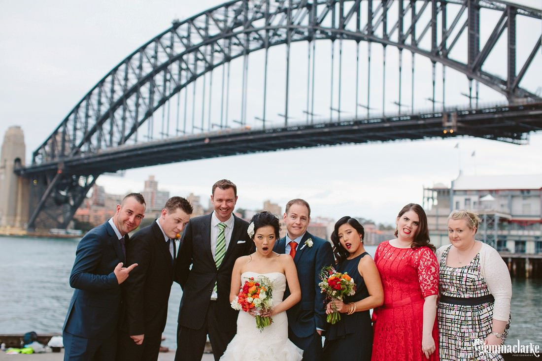 A bridal party making funny faces with Sydney Harbour Bridge in the background - Simmer on the Bay Wedding