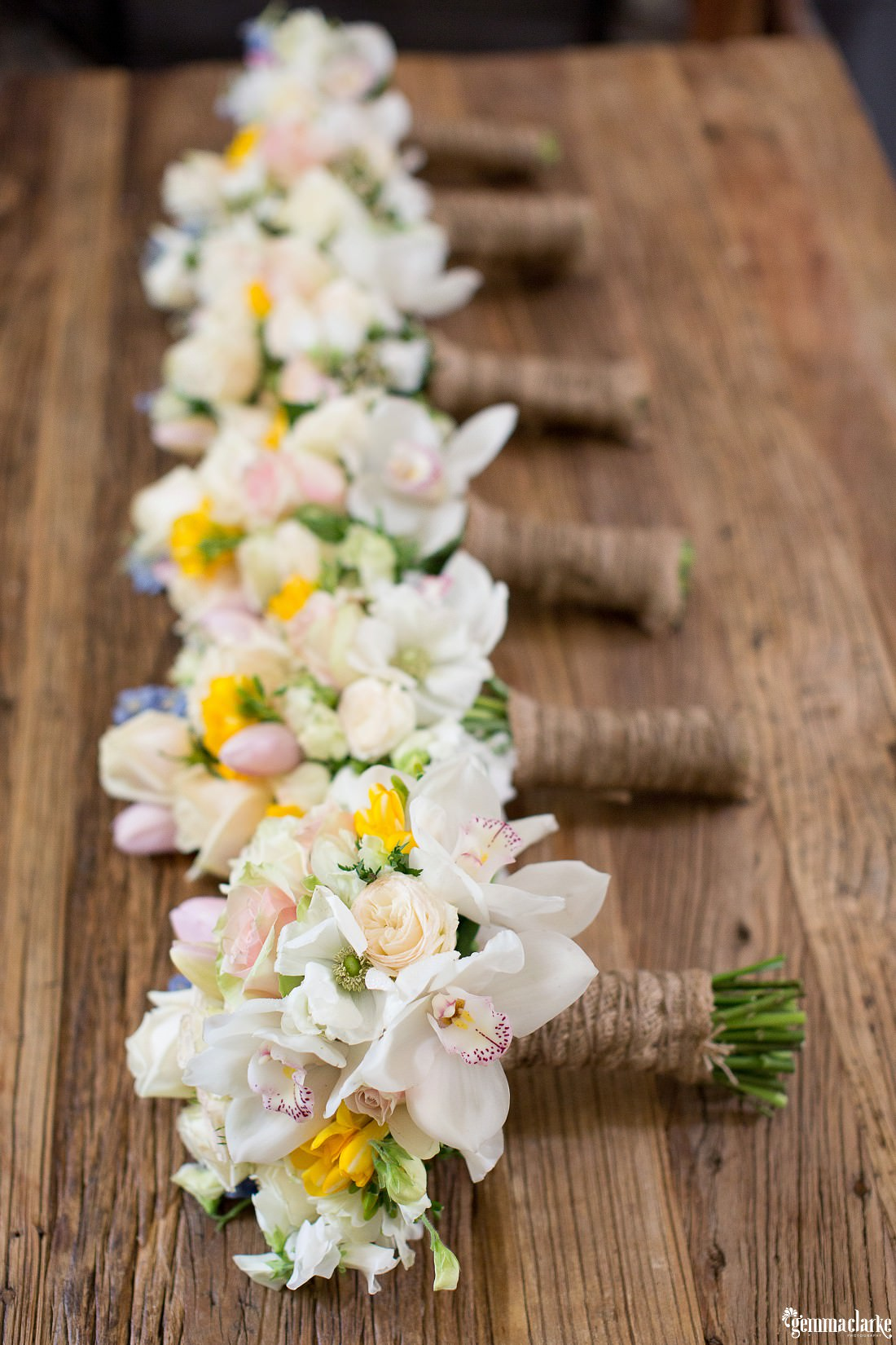 Bride and bridesmaids' bouquets of light coloured flowers - Robert Oatley's Vineyard Wedding