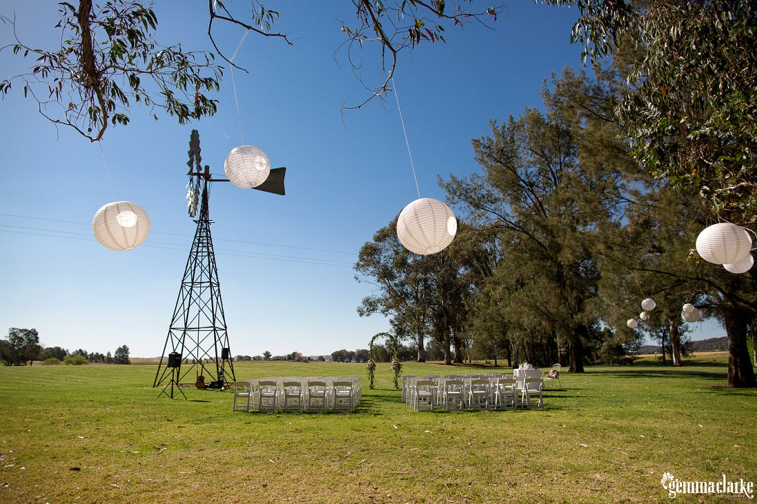 Outdoor wedding ceremony setup at a vineyard by a windmill - Robert Oatley's Vineyard Wedding