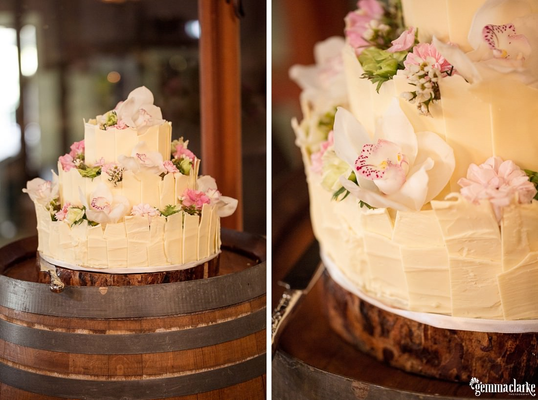 Three tier naked cake with floral decorations - Robert Oatley's Vineyard Wedding