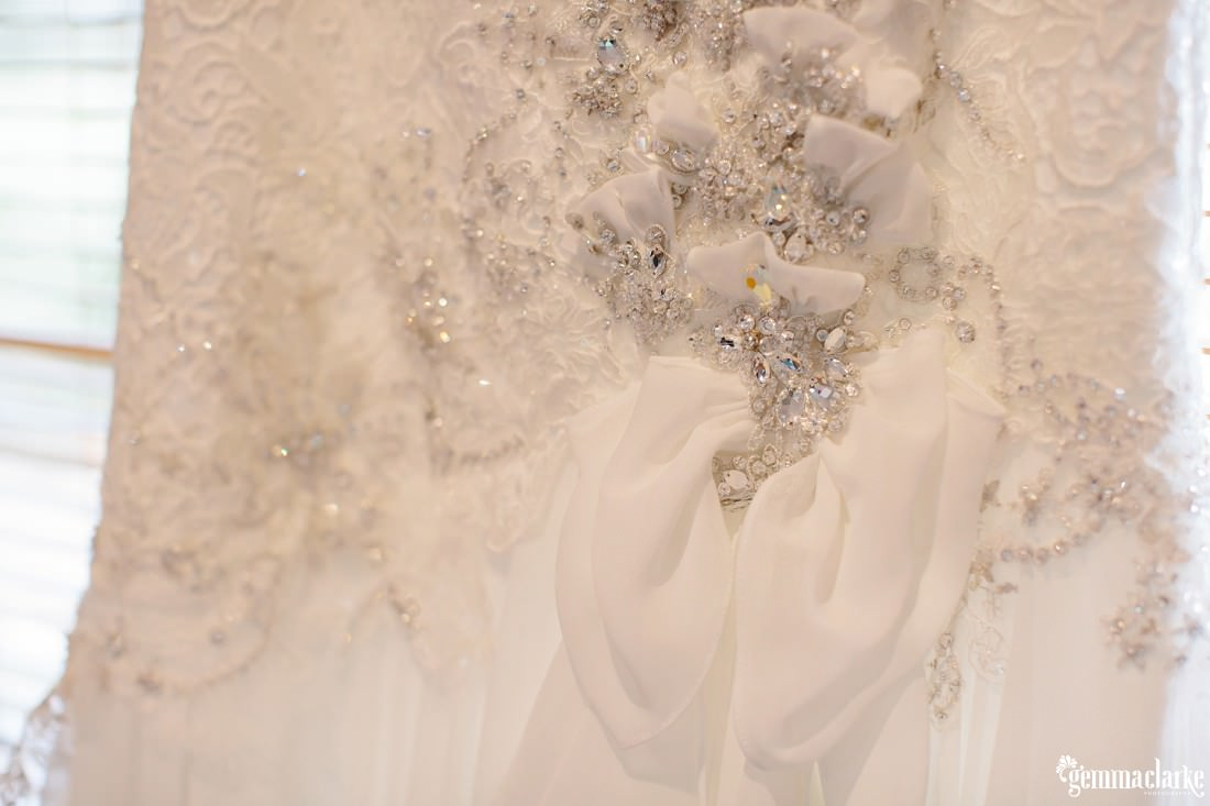 A closeup of the detail on a bridal gown