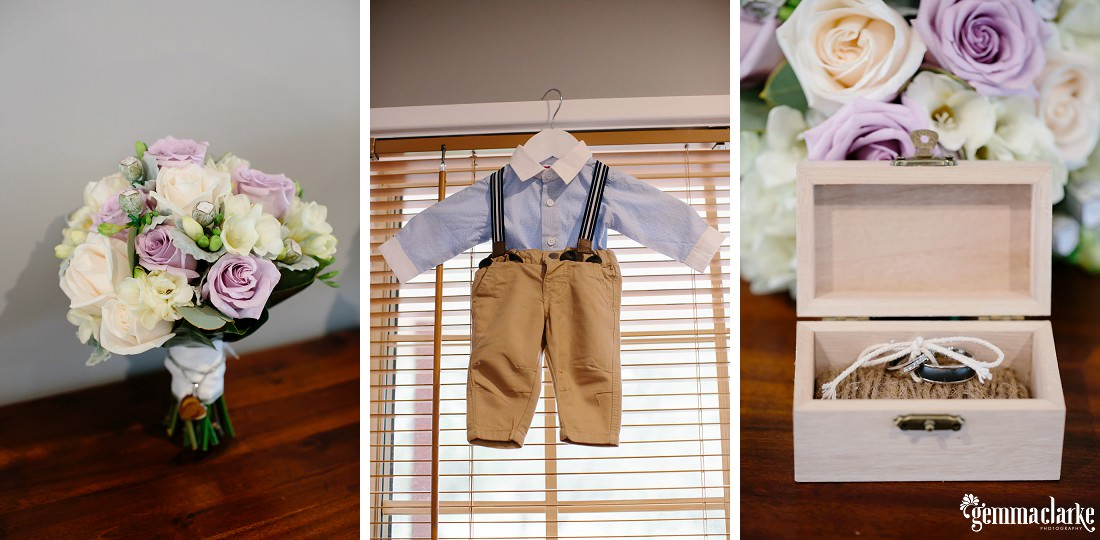 A small boy's formal attire on a hangar, a floral bouquet and a ring in a small wooden box