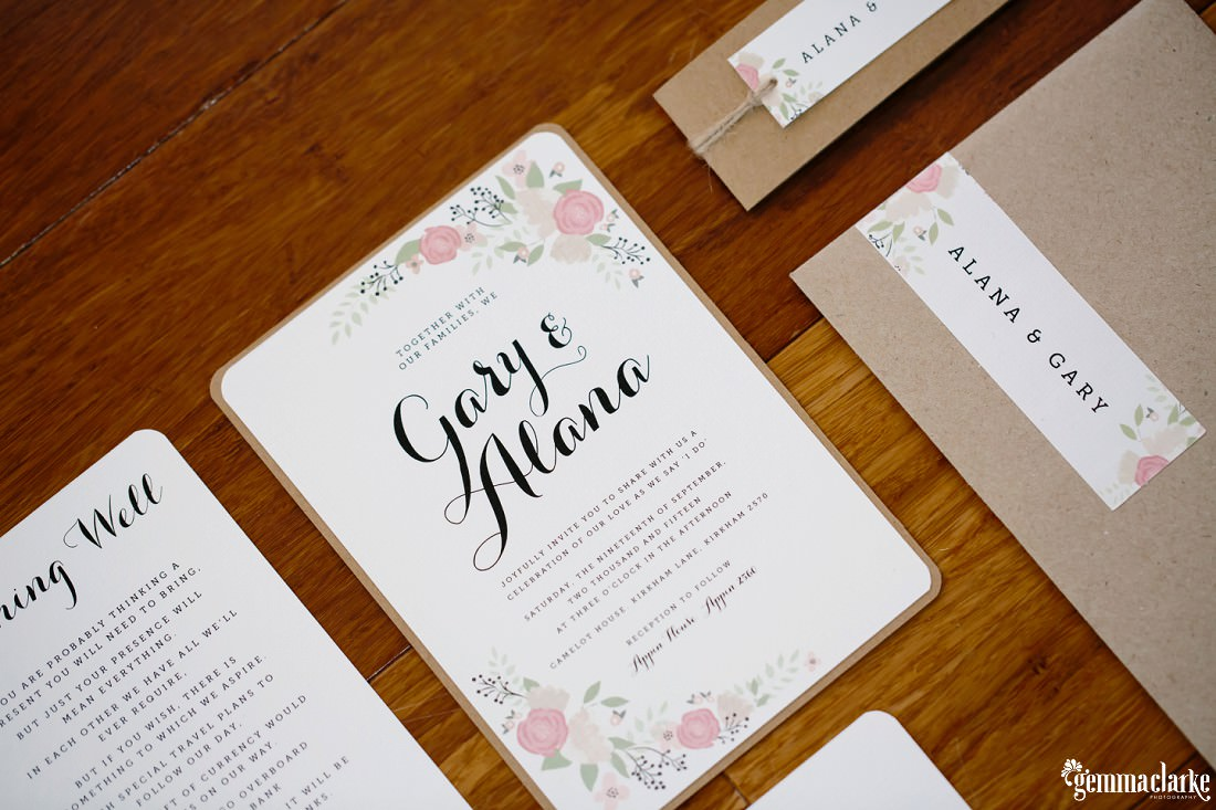 Various wedding stationery on a wooden table