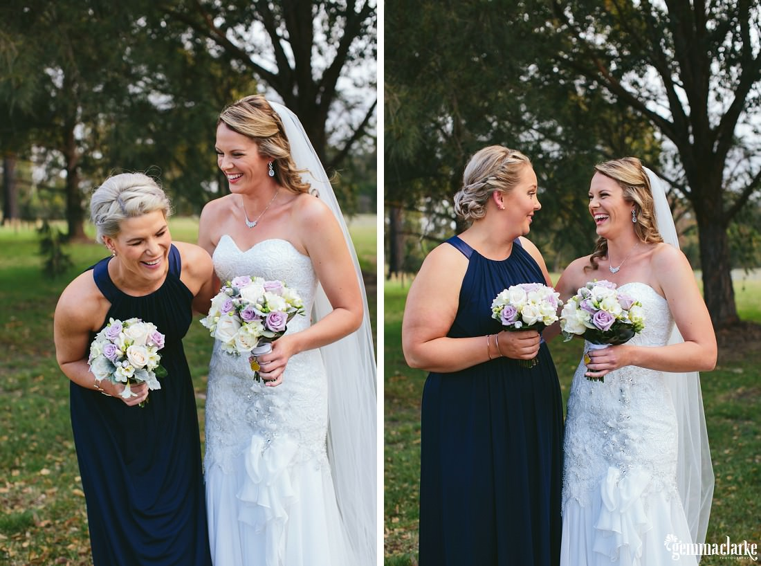 A bride smiling and laughing with her bridesmaids