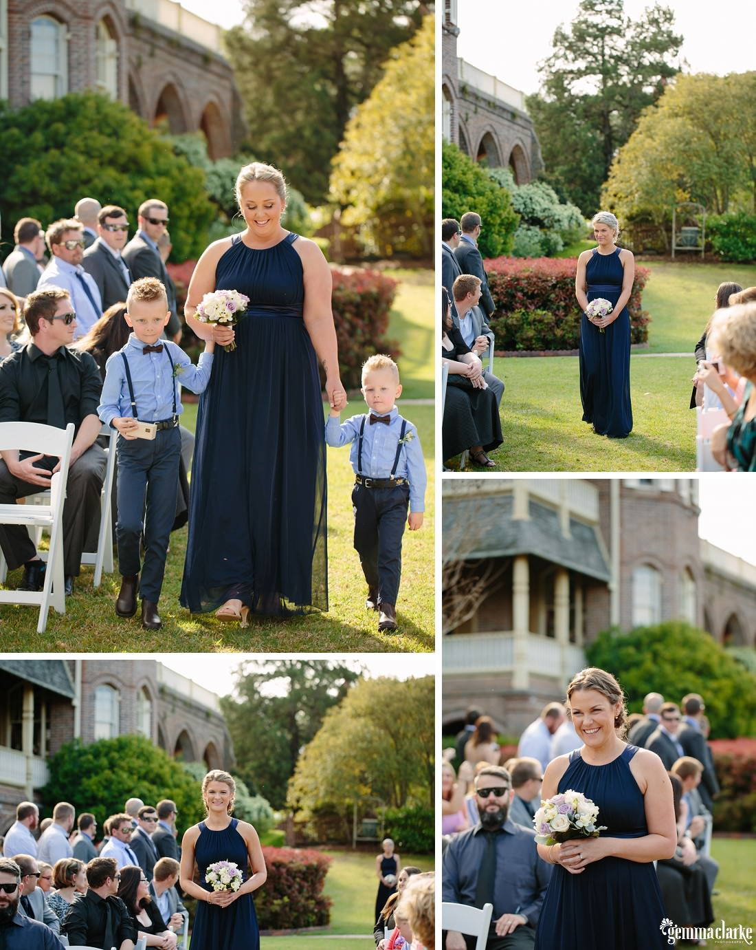 Bridesmaids and two young boys walking down the aisle of an outdoor wedding ceremony