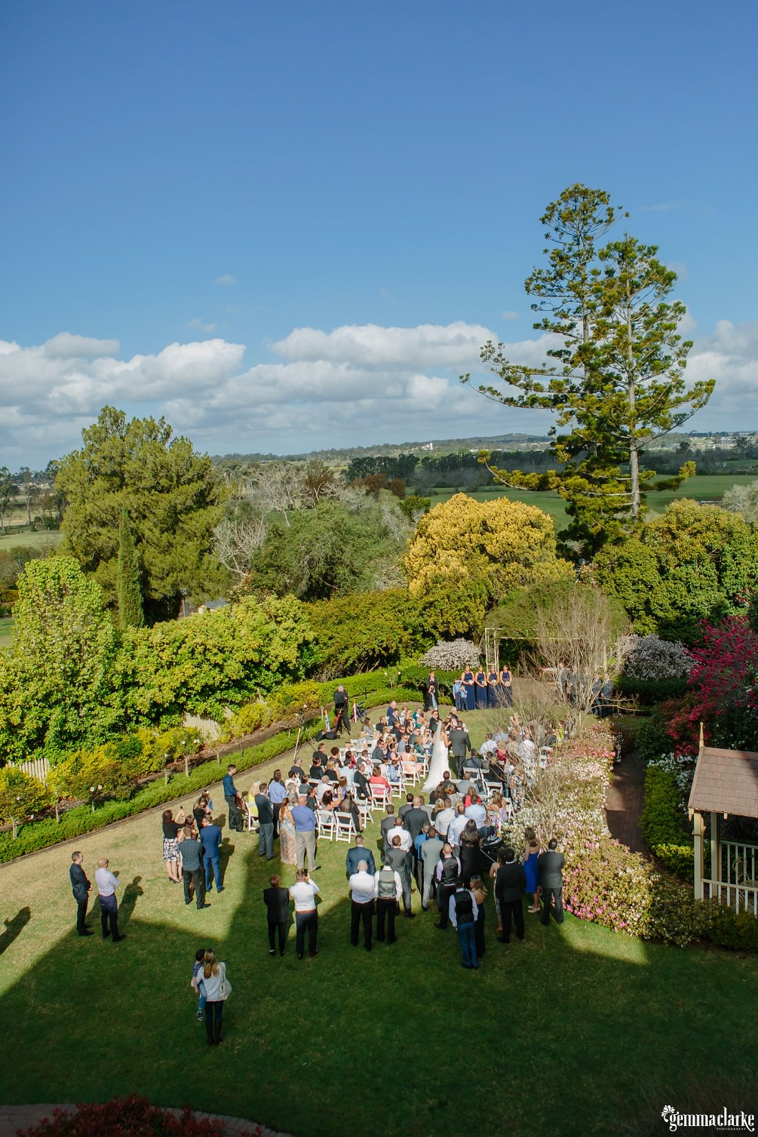 An overhead shot of an outdoor wedding ceremony in progress