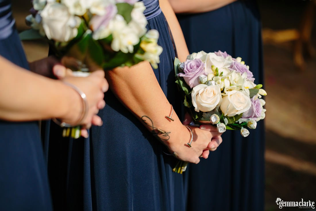A close up of bridesmaids holding their bouquets