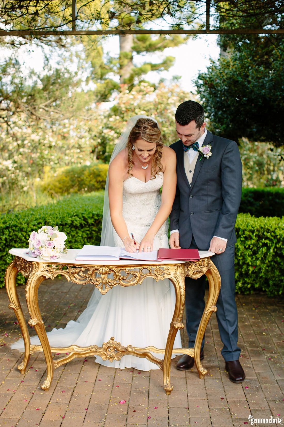 A bride and groom at their signing table
