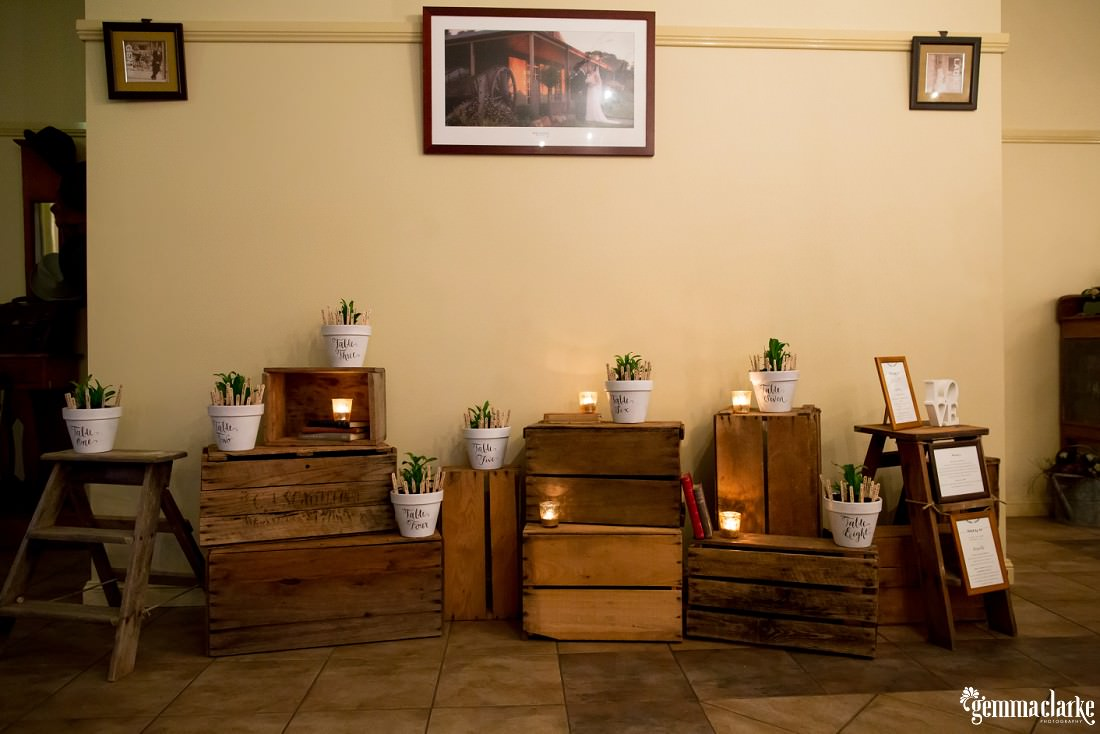 Candles and plants on various wooden boxes