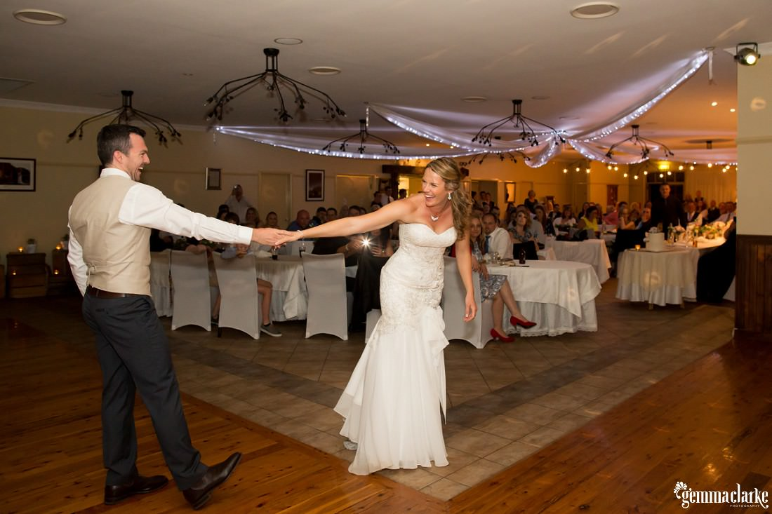 A bride and groom sharing their first dance at their reception