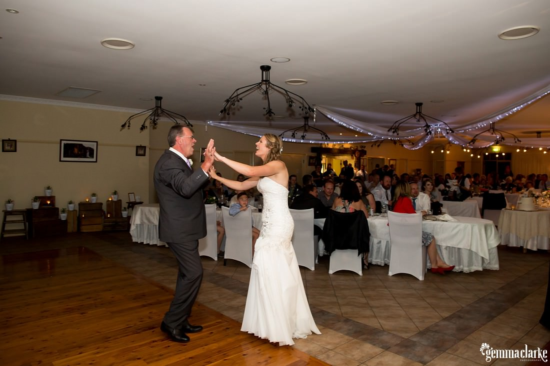 A bride and her father dancing at a wedding reception