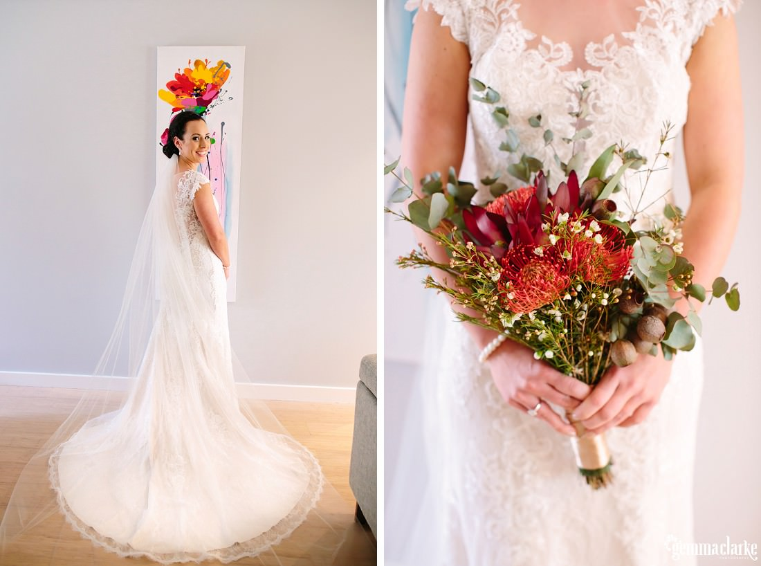 A smiling bride posing to show off her dress and her bouquet of native Australian flowers