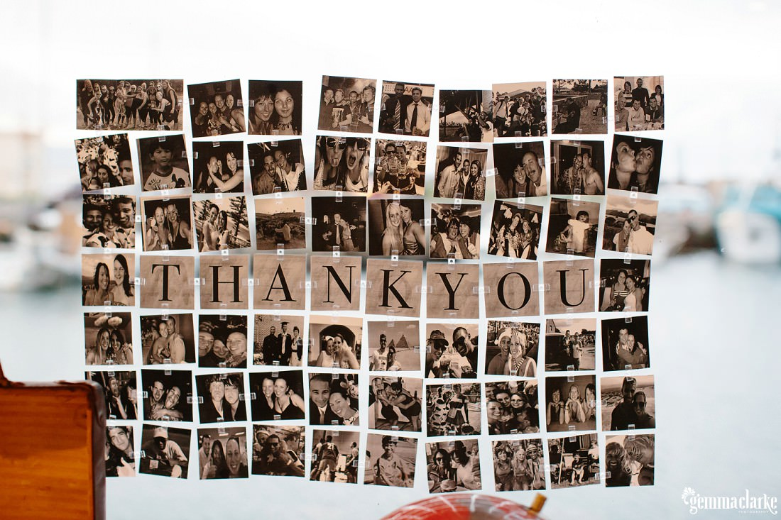 A thank you sign among lots of photos